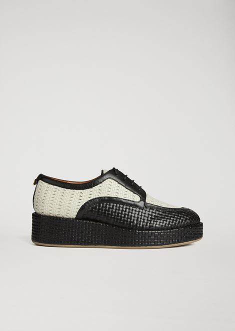 Platform derby in woven leather