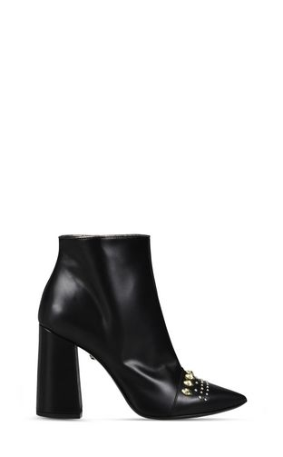 High leather ankle boot with studs