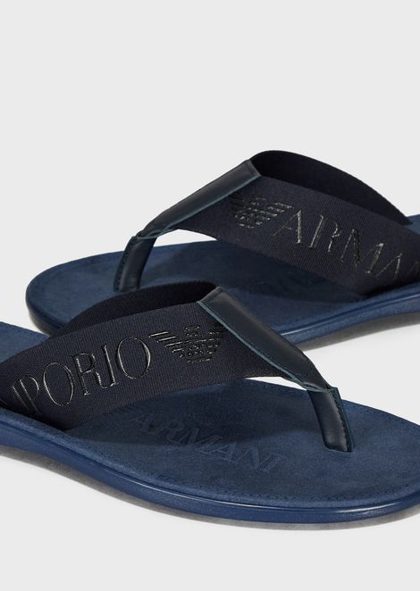 Flip-flops with fabric straps with tone-on-tone logo
