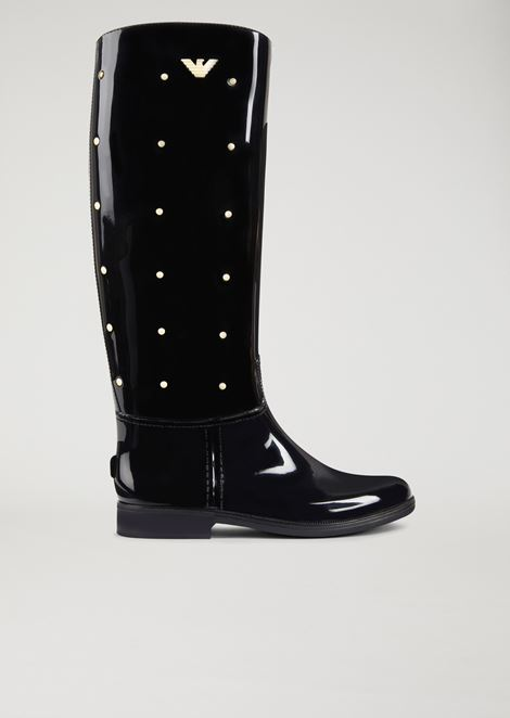 Rubber boot with decorative studs and logo