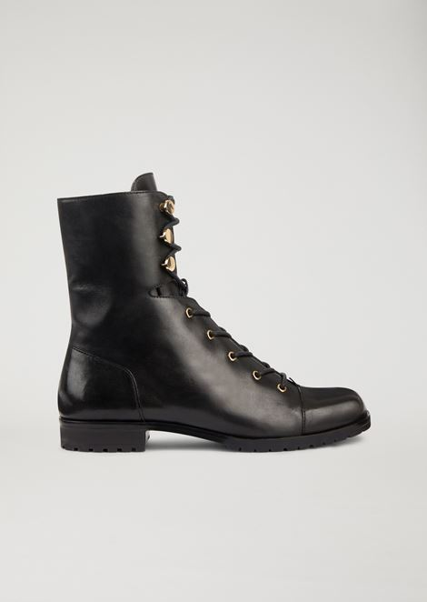 Leather combat boots with golden metal details