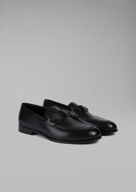Brushed leather loafers featuring saddle strap with metal logo detail