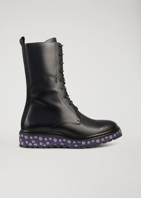 Leather combat boots with floral pattern platform sole