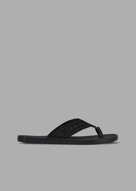 Flip-flops with bands of logoed fabric and leather details