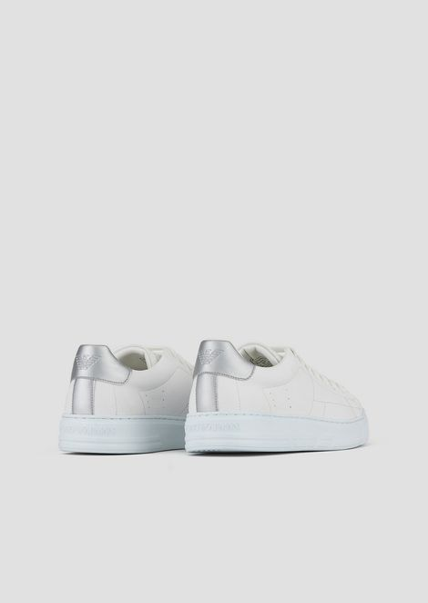 Sneakers with metallic back and logo on the sole