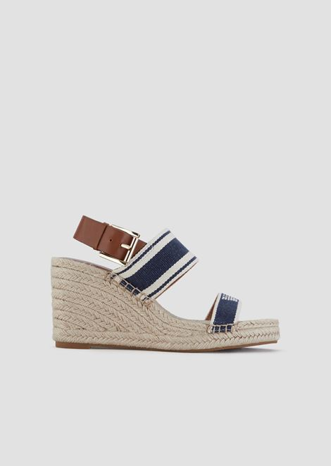 Sandals with straw wedge and leather buckle