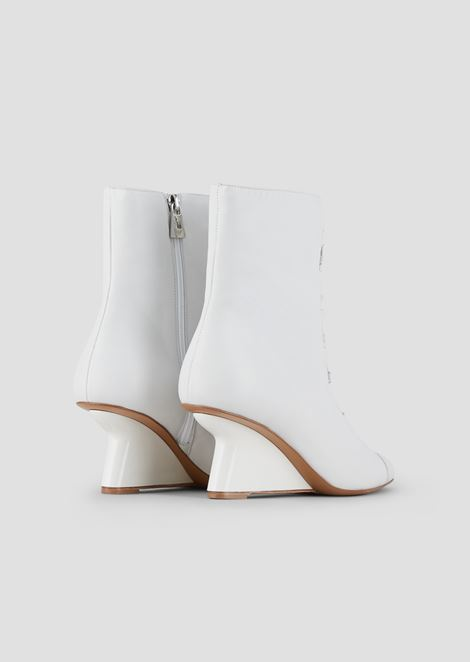 Ankle boots in nappa leather with strap and asymmetric wedge