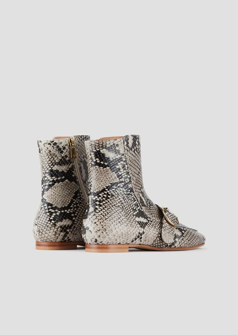 Booties in python-print leather with strap and buckle