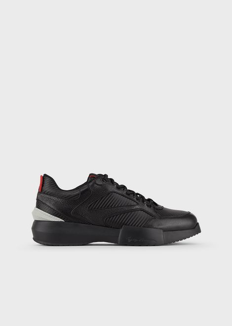 Sneakers with oversized deerskin soles and carbon cloth details