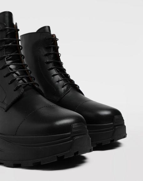 MAISON MARGIELA Leather combat boots Ankle boots Man a