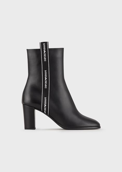 Leather heeled booties with logo strap