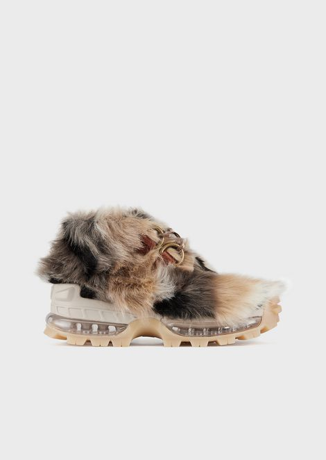 Leather hiking boots covered in faux fur