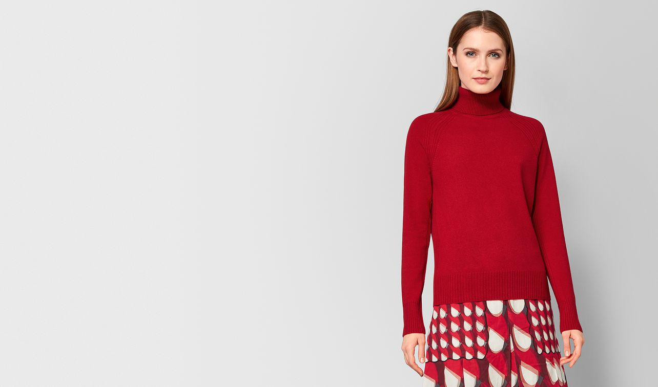 red cashmere sweater landing