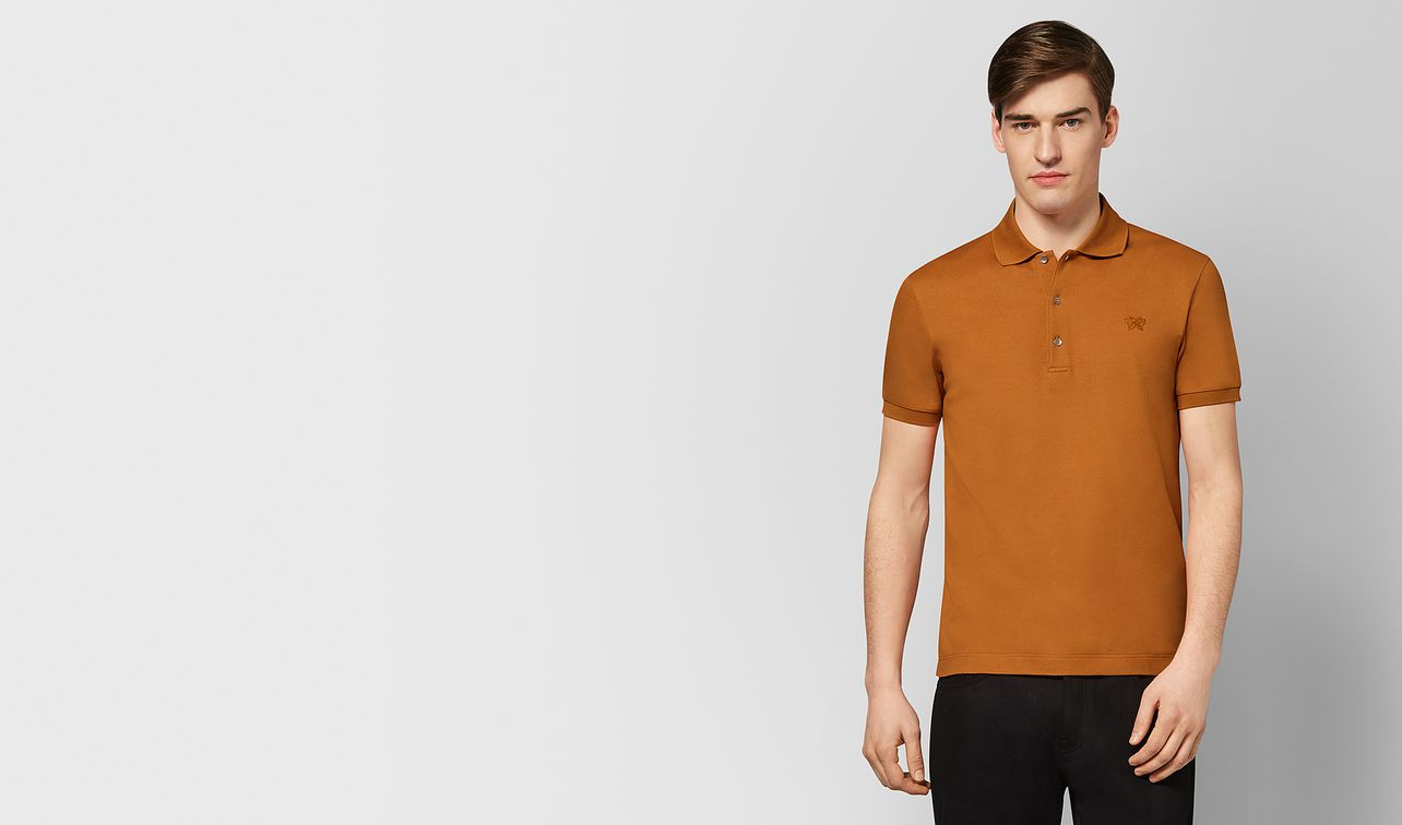 orange cotton polo landing