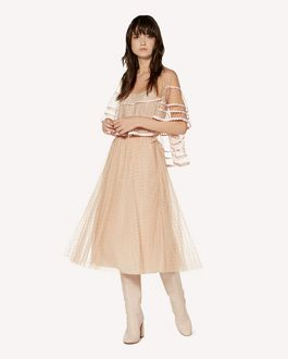 REDValentino Tulle point d'esprit poncho with zagana ribbon detail.