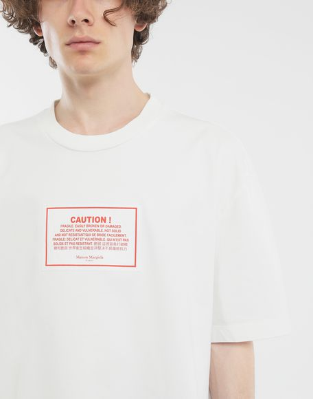 MAISON MARGIELA 'Caution' label T-shirt Short sleeve t-shirt Man a