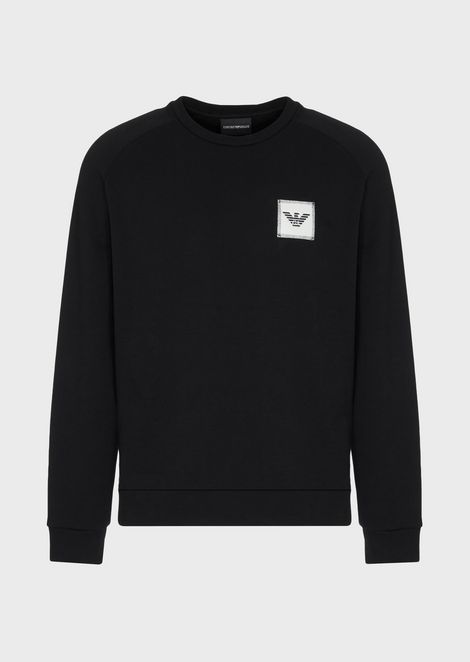 Sweatshirt with stitched eagle patch