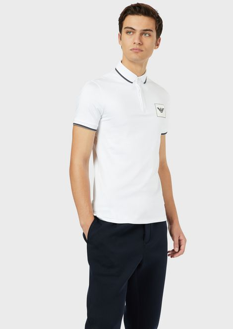 Jersey polo shirt with stitched logo patch
