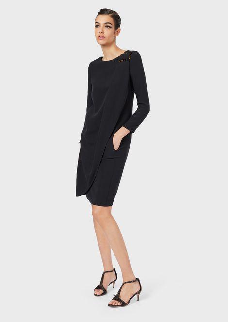 Dress with draped fabric and tortoiseshell buckle