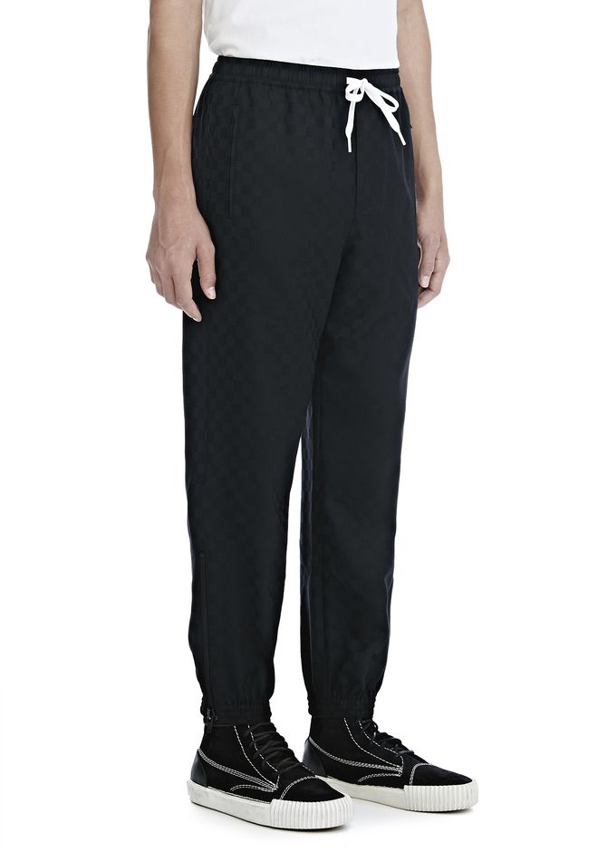 ALEXANDER WANG PANTS Men CHECKERBOARD WOOL JACQUARD TRACK PANTS