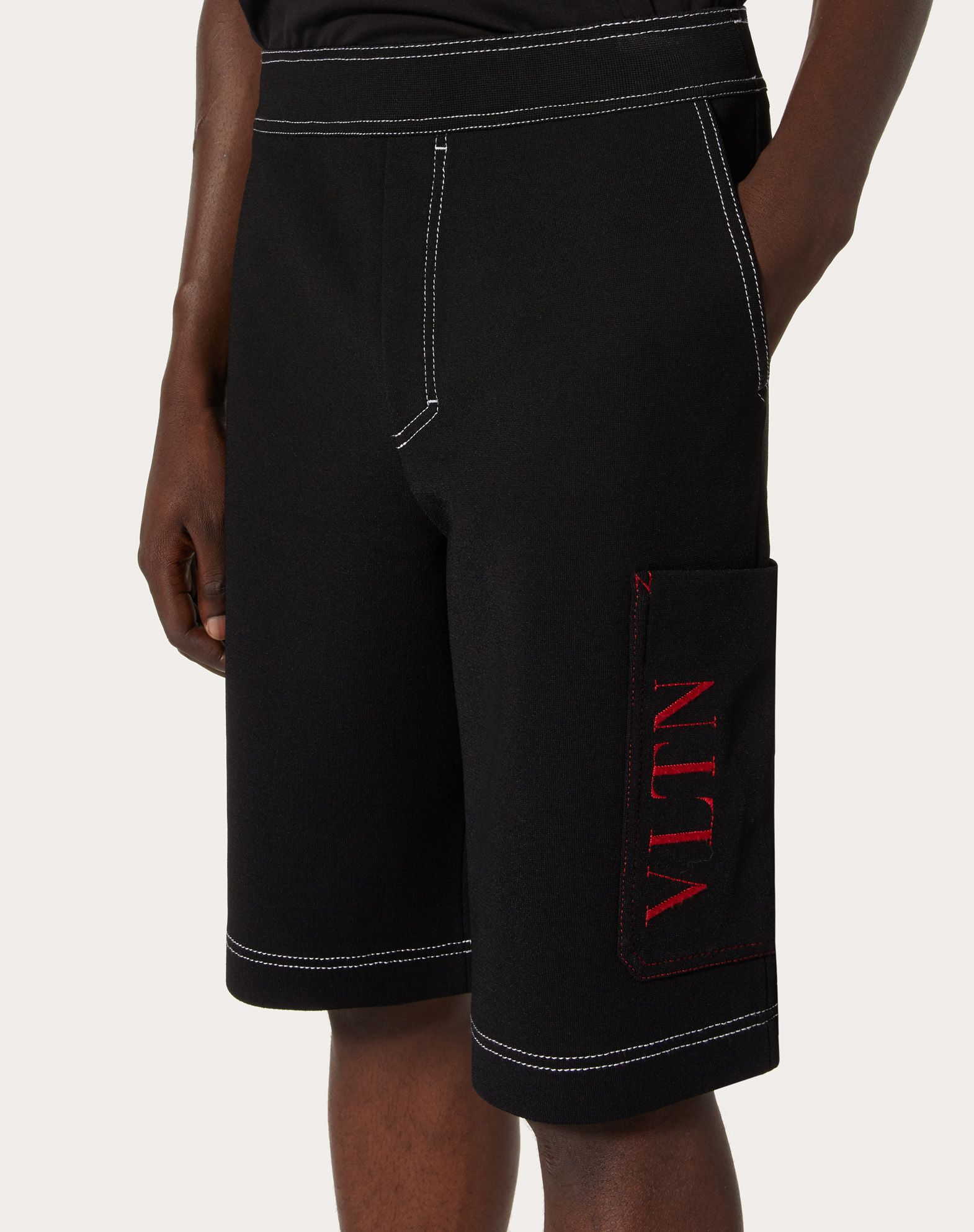 VALENTINO UOMO Cropped knit trousers with VLTN logo Shorts U a