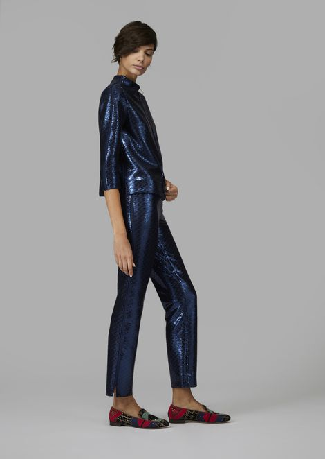Flared trousers covered in sequins with fabric detail