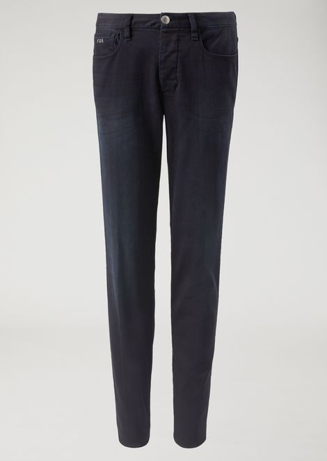 J11 jeans in dark rinse denim with used effect bleaching