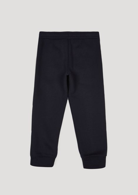 Jogging trousers in cotton fleece with side stripes and zip