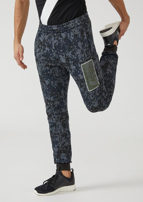 Joggers with camouflage pattern and printed EA7 logo