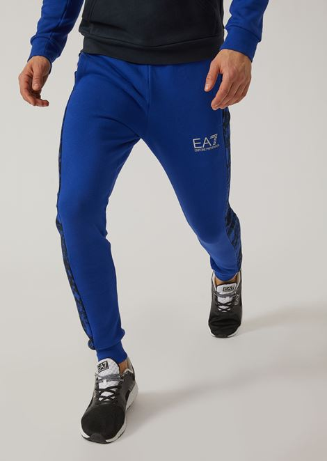 Joggers with camouflage inserts and logo