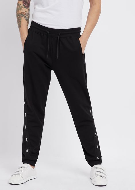 Jogging pants in stretch viscose interlock with logo bands