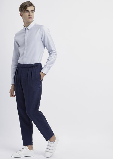 Trousers in textured jersey with pleats and side strap