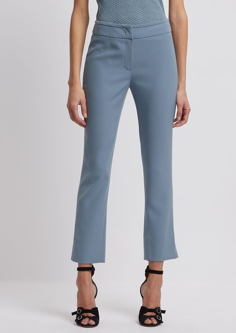 Cropped pants with slit at ankle hem