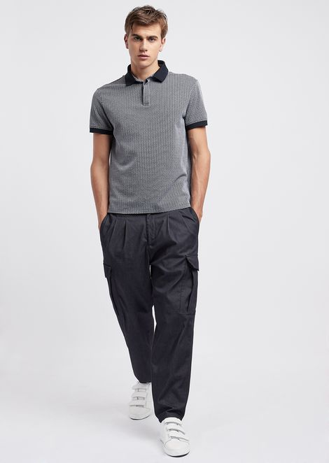 Stretch tech denim trousers with cargo pockets and elasticated waist