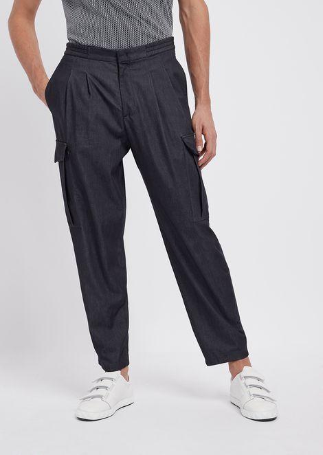Stretch tech denim pants with cargo pockets and stretch waist
