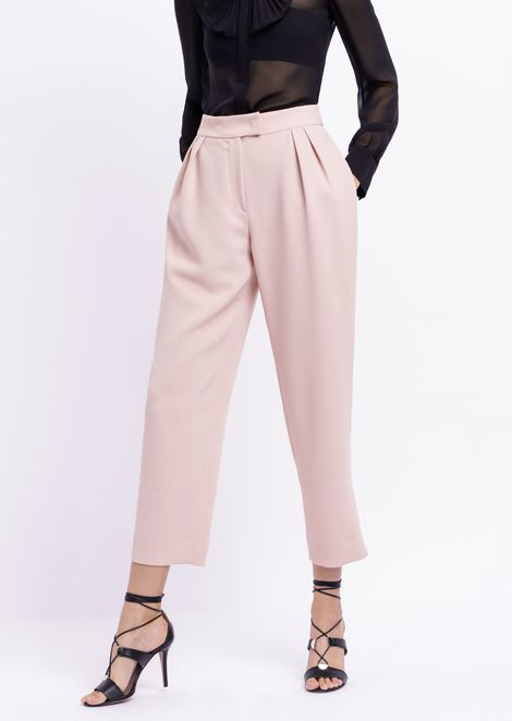 Trousers with pleats in technical crepe fabric
