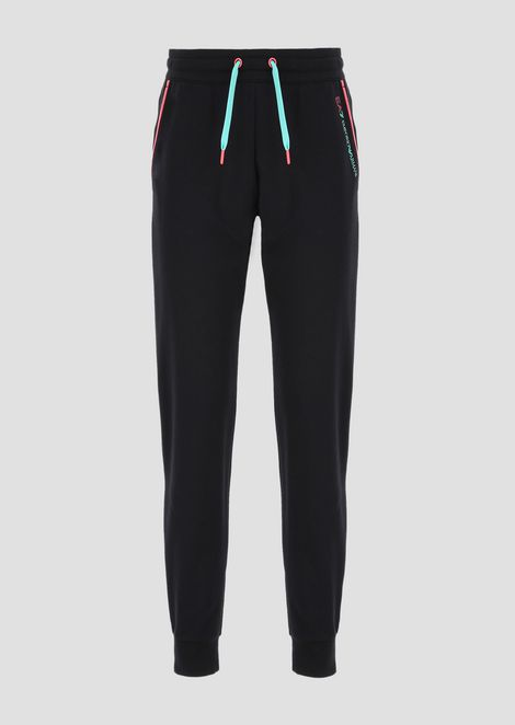 Pantaloni jogging in french terry con zip a contrasto