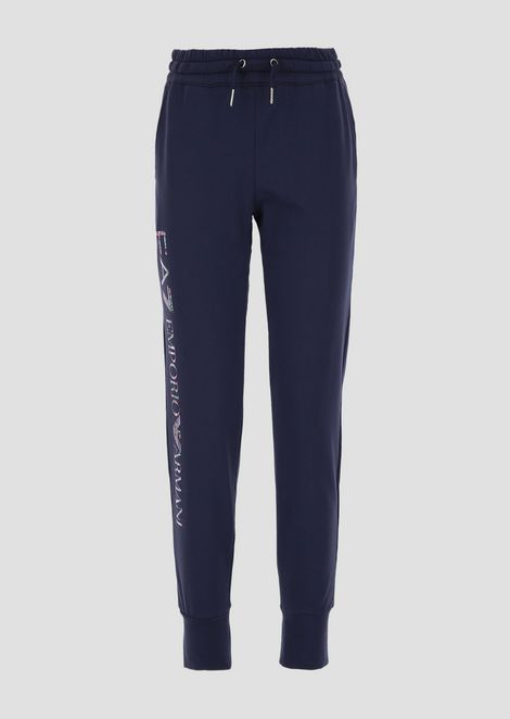 Pantaloni jogging in french terry con logo sulla gamba