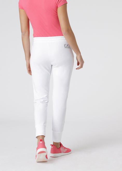 Pantalones deportivos de algodón elástico con estampado floral y logotipo