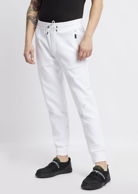 Pantaloni joggers in cotone stretch con logo tape