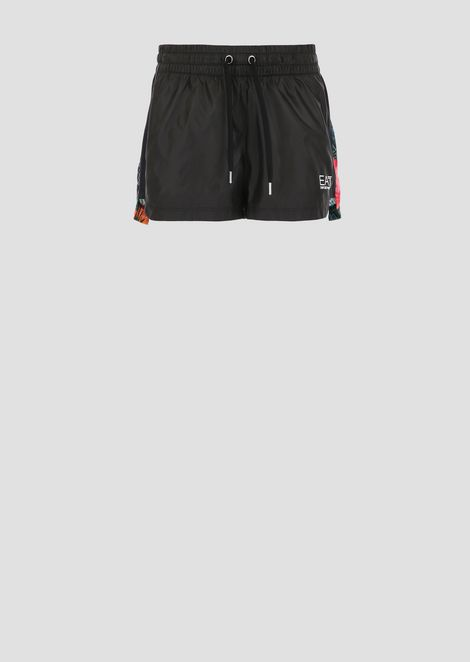 Windproof tech fabric shorts with tropical pattern on the back