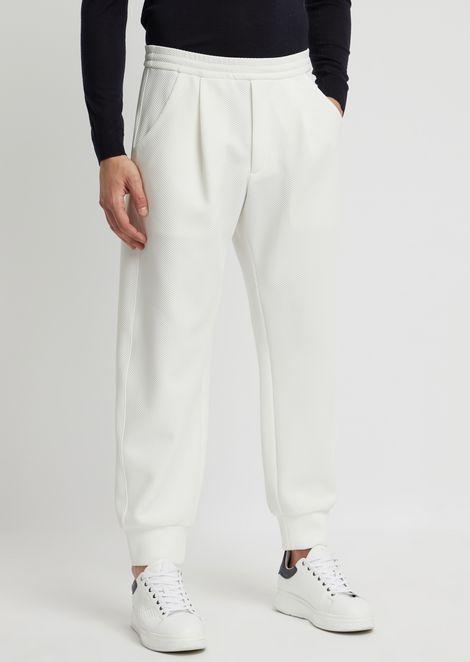 Pantalones deportivos en punto panal laminado