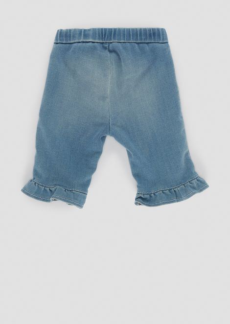 Jeans in light denim with ruches on the hem
