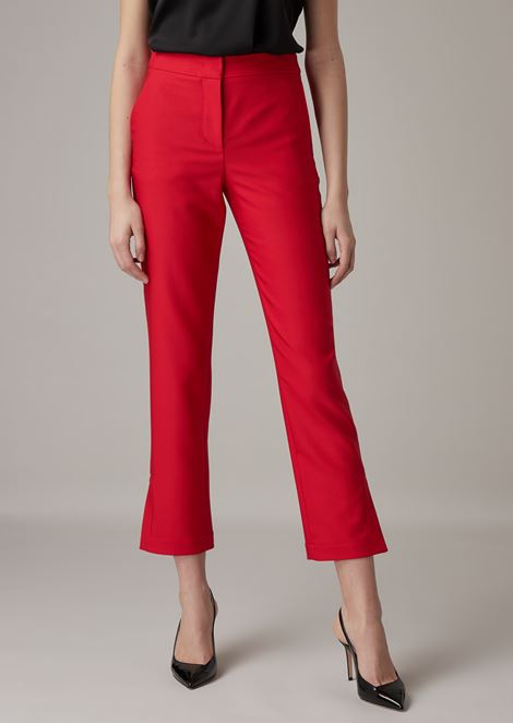 Trousers with short flared hemline and side slits
