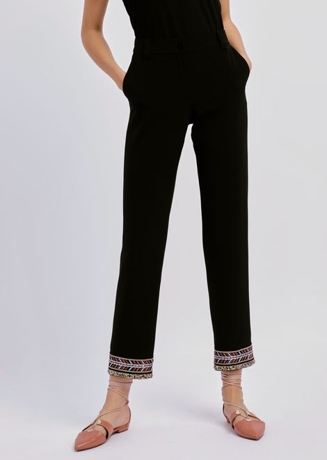 Trousers in techno tricotine with bead embroidery on the hem