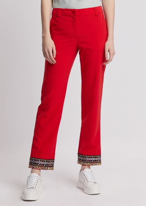 Trousers in techno tricotine with beads embroidery on the hem