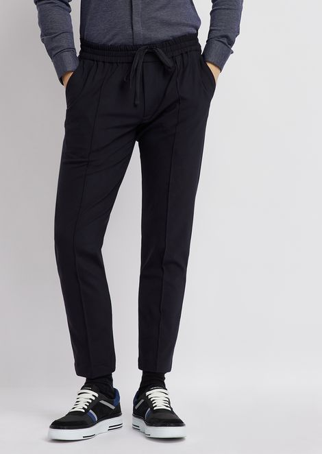 Trousers in technical wool with elasticated waistband and pleats