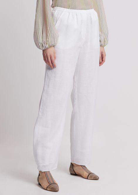 Oversized linen trousers with buttons at hem
