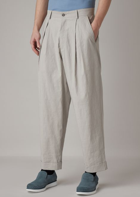 Pantaloni con ampie pinces in tela stretch tumblerata in capo