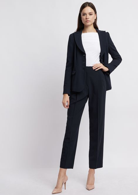 Trousers with pleats in chevron jacquard fabric